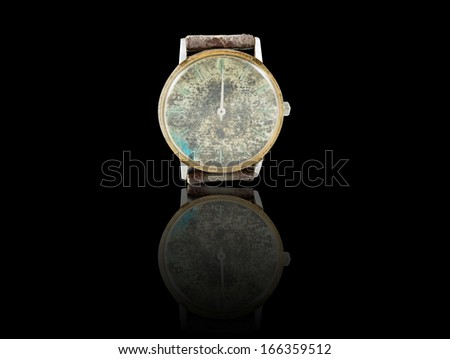 Old watch with leather on black background - stock photo