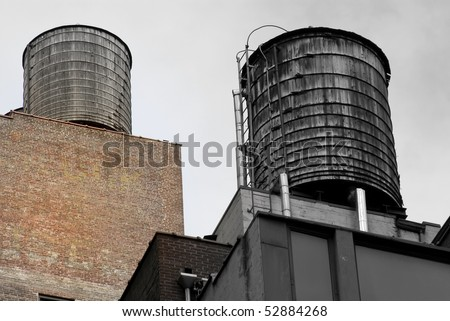 Old water tanks on the roof in New York city - stock photo
