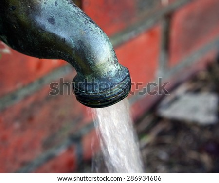 old water tap details closeup - stock photo