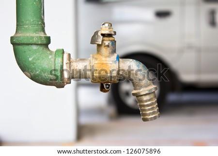 Old water valve - stock photo