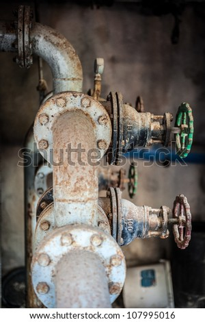 Old water valves - stock photo
