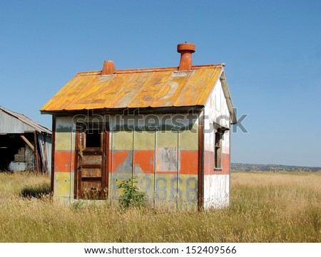 old weathered abandoned small painted building  - stock photo