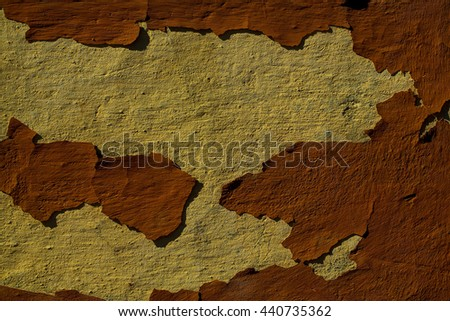 Old weathered cement wall with cracked brown faded paint textured background - stock photo