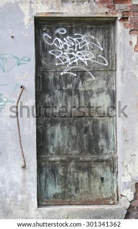 Old weathered door, grunge background - stock photo