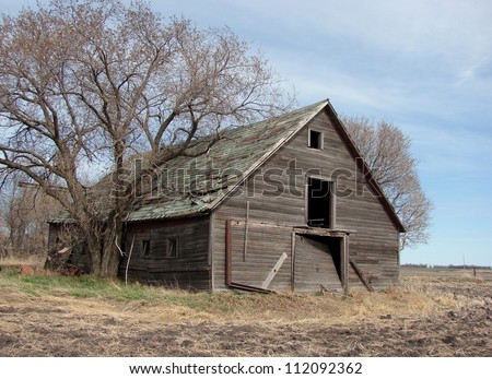 old weathered farm buildings shed - stock photo