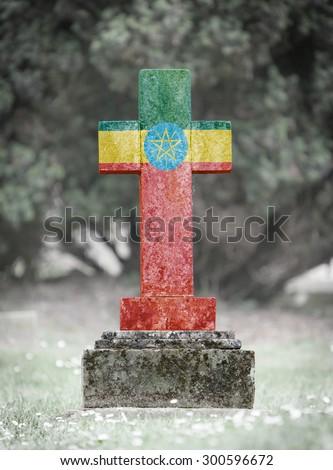 Old weathered gravestone in the cemetery - Ethiopia - stock photo