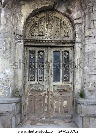 Old weathered gray wooden vintage door with decoration pattern