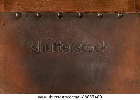old  weathered leather tacked - stock photo