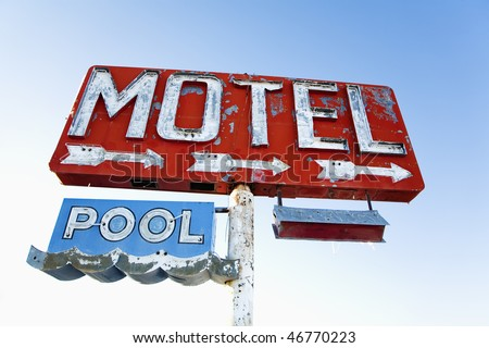 Old weathered retro neon motel sign advertising pool and vacancy. Horizontal shot. - stock photo