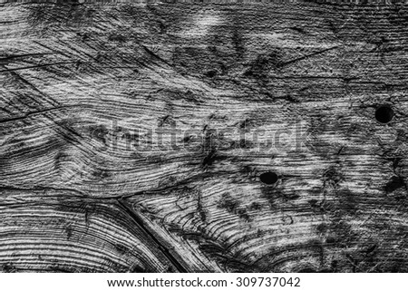 Old Weathered, Rotten, Cracked, Square Timber Bollard, Bleached and Stained Gray, Grunge Surface Texture Detail. - stock photo