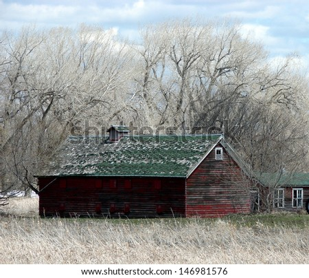 old weathered rural buildings red granary - stock photo