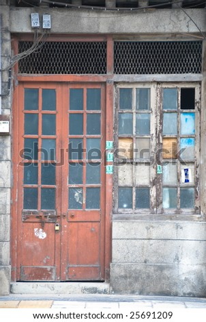 old weathered shophouse entrance - stock photo