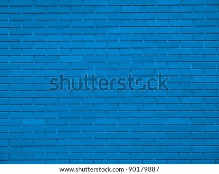 Old weathered stained blue brick wall background - stock photo