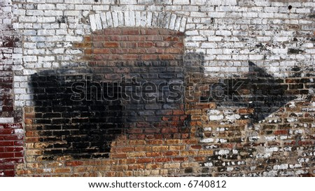 Old weathered urban wall with bricked up window - stock photo