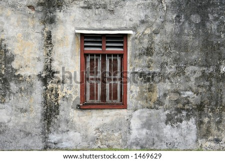Old weathered wall with a window