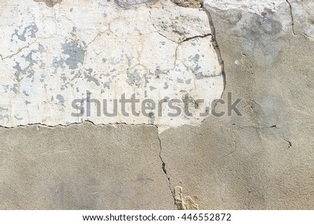 Old weathered white cement wall for design