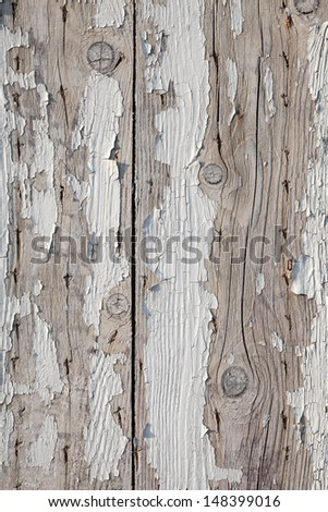 Old weathered wooden wall with flaking paint. Vertical photo background texture - stock photo