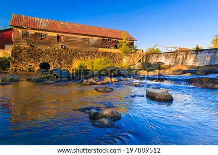 Old weathered wooden water mill building, Moscow, Vermont, USA - stock photo