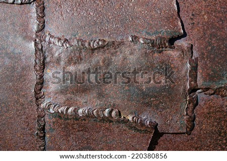 old welded patched rusty and corroded metal background texture - stock photo