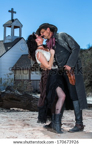 Old West Man and Woman About to Kiss - stock photo