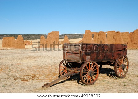 old west wagon and adobe ruins - stock photo