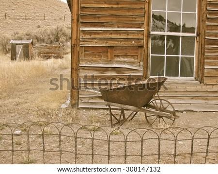 Old wheelbarrow in Bannack, MT - stock photo