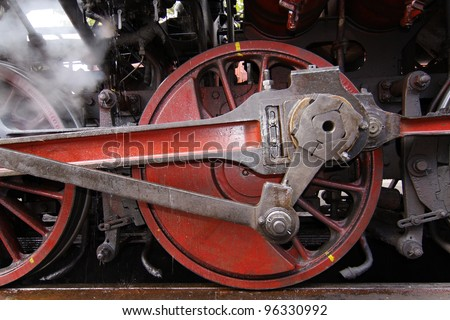 old wheels of a steam locomotive - stock photo
