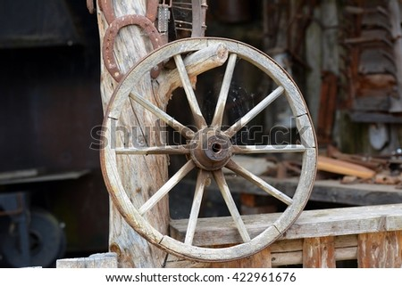 Old wheels of the buggy - stock photo