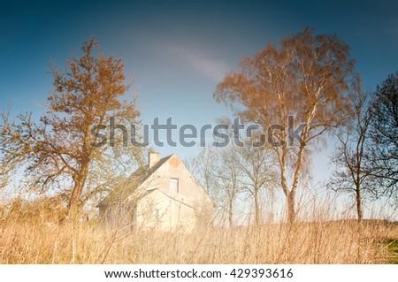 Old white abandoned house - stock photo