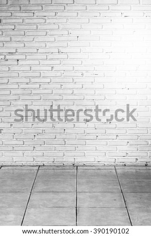 old white brick wall and floor in the room