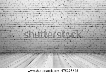 Old white brick wall and wooden floor. Textured background. Copyspace. Rough-surfaced.