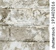 Old white brick wall fragment as a background texture - stock photo