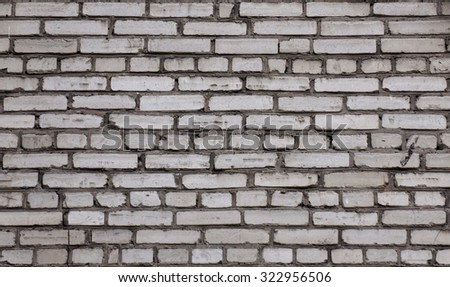 Old white brick wall. The wall of the old brick white. Sloppy brickwork - stock photo