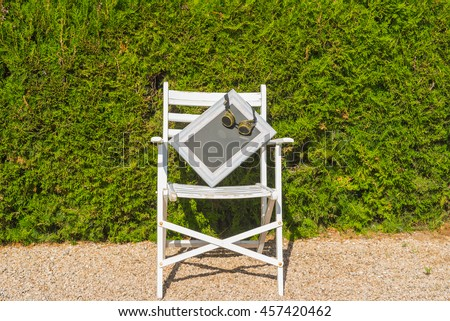Old white chair with a blank space for writing and  glasses