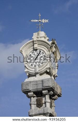 old white clock in spain - stock photo