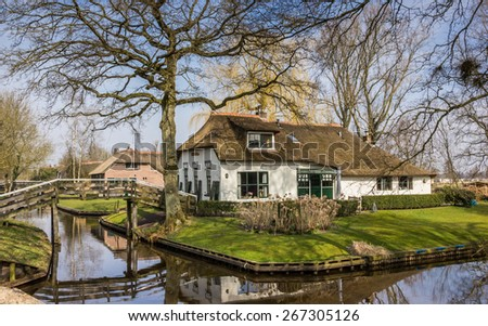 Old white farm in historical village Giethoorn, Holland - stock photo