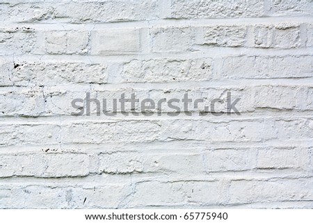 old white painted bricks at an old house wall - stock photo
