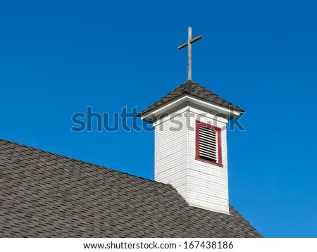 Old White Rural Church Steeple and Belfry Against Blue Sky - stock photo