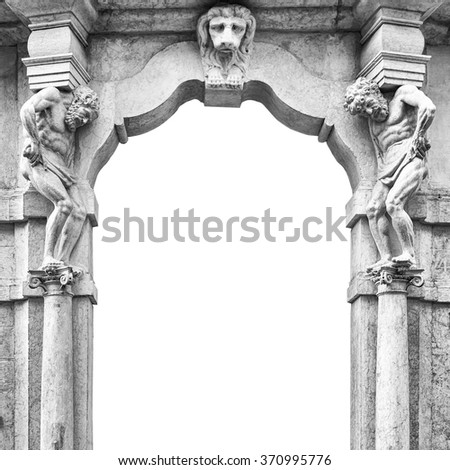 Old white stone entrance with statues that support the side columns. - stock photo