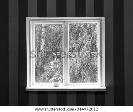Old white wood window in striped brown and yellow wall black and white - stock photo