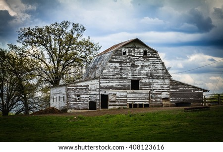 Old White Wooden Barn - stock photo
