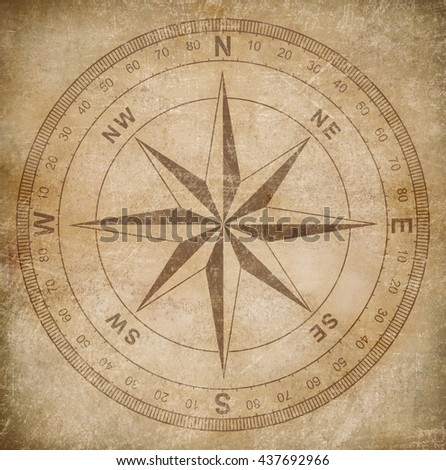 old wind or compass rose on grunge paper