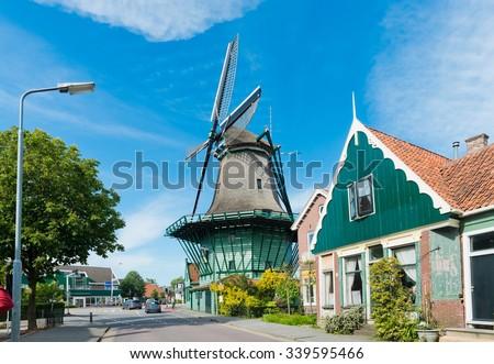 "Old windmill ""De Bleeke Dood"" (The Pale Death) in Zaandijk (near Amsterdam). The Netherlands  - stock photo"