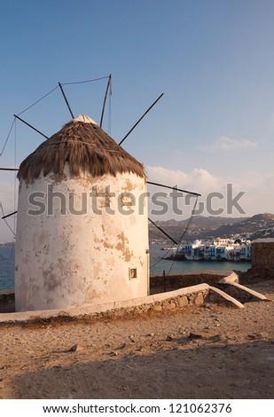 Old windmill of Mykonos on the background of Little Venice. Mykonos. Greece. - stock photo