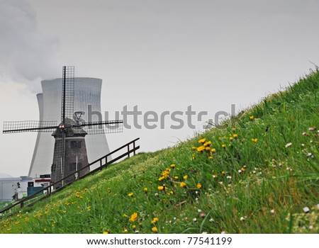 Old windmill with nuclear cooling towers in the back, Antwerp