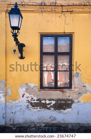 Old window and street lamp - stock photo