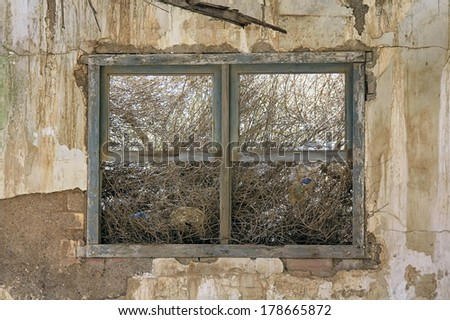 Old window destroyed house in ruins and abandoned - stock photo