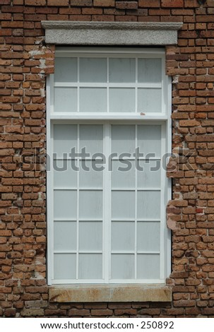 Old window in brick building - stock photo