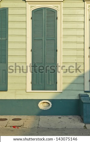 Old window in French Quarter near Bourbon Street in New Orleans, Louisiana - stock photo