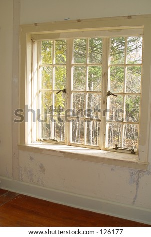 Old window in haunted house with peeling white lead based paint - stock photo